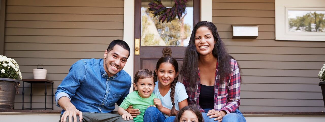 Image of a family sitting on a front porch